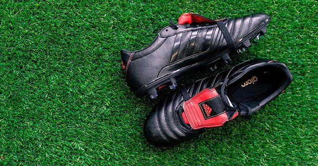 Image of an adidas Gloro 15.1 in Black and Red.