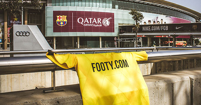 Image of a FOOTY.COM shirt outside of the Camp Nou in Barcelona