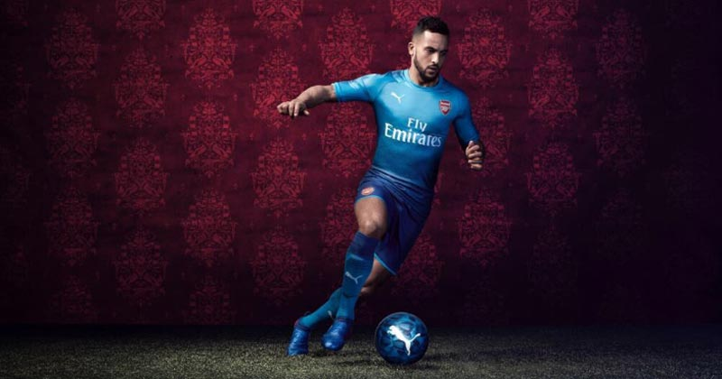Image of Theo Walcott showing off the new strip
