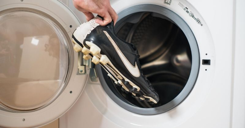 putting leather football boots into the washing machine