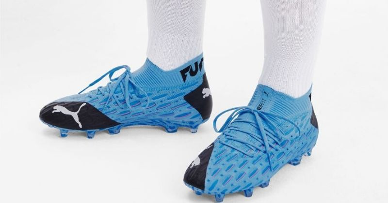 bright blue and black puma future football boots