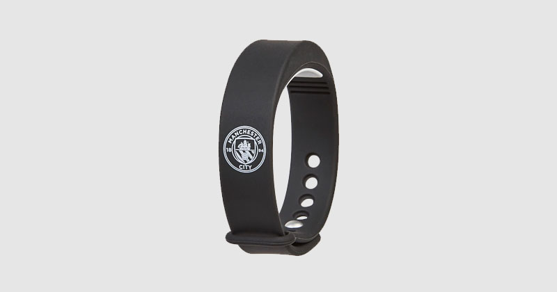 black fitness tracker with man city crest