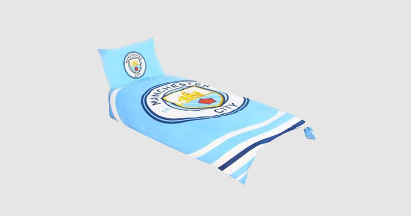 blue man city bedding featuring large club crest on the duvet and pillow