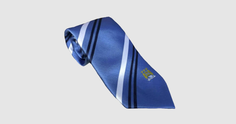 blue striped tie with man city crest
