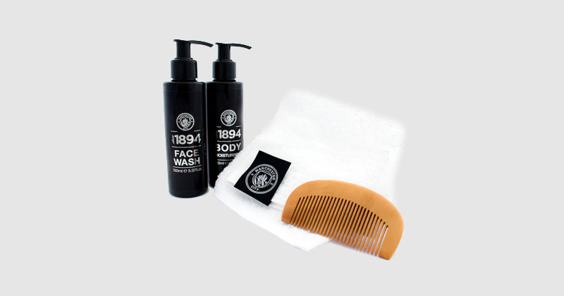 hair comb, face towel and toiletries featuring the city crest