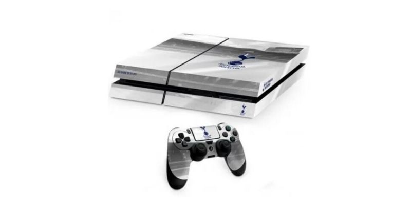 ps4 consoleand controller covered in a special edition spurs skin