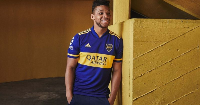 player modelling the boca juniors 2020 home kit
