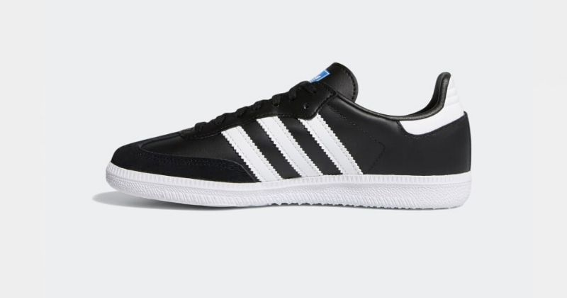 black and white adidas samba football trainers