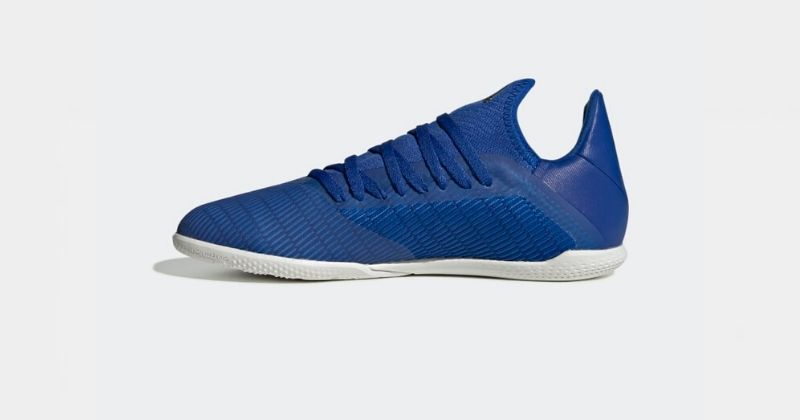 blue and white adidas x indoor football trainers