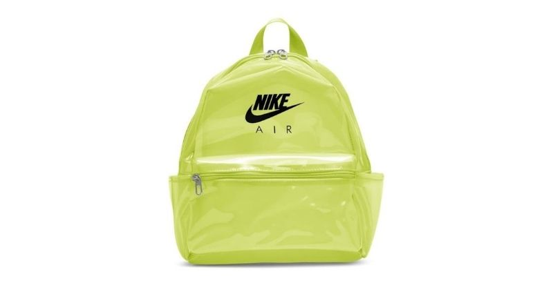 nike just do it mini backpack in yellow on white background