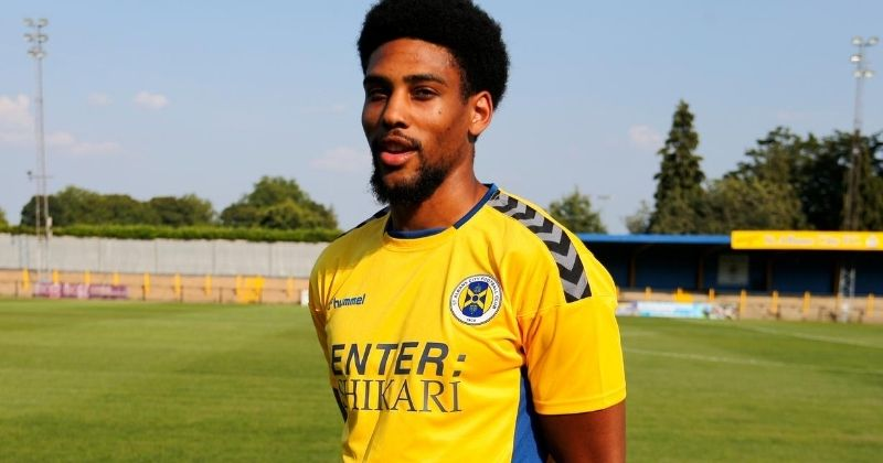 player wearing the 2020-21 st albans city home kit, sponsored by Enter Shikari