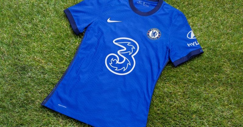 chelsea 2020-21 home kit laid out on a patch of grass