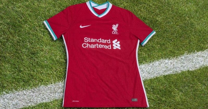 liverpool 2020-21 home kit laid out on grass