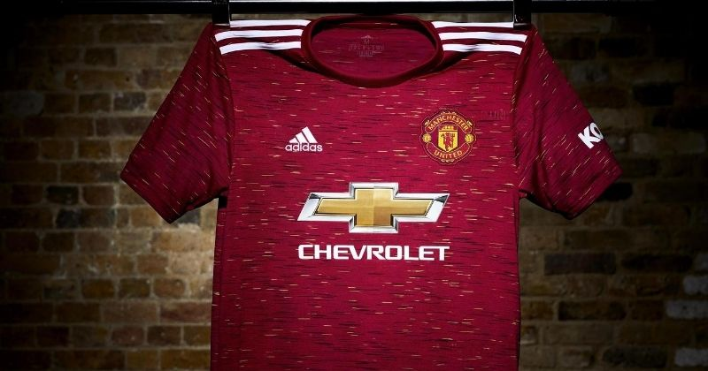 manchester united 2020-21 home kit hung up on display