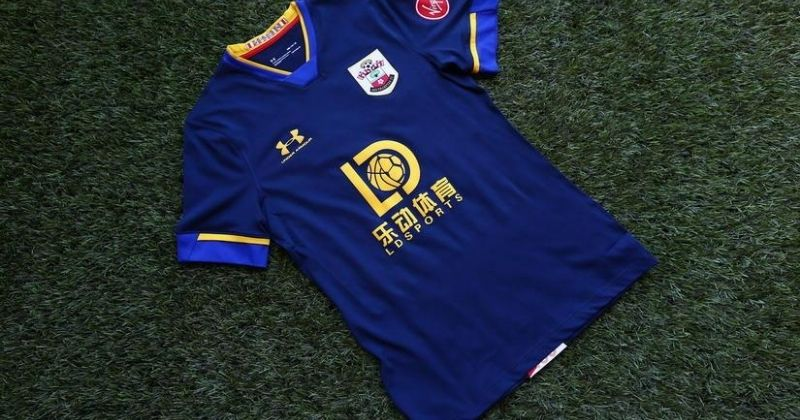 navy 2020-21 southampton away kit laid out on grass