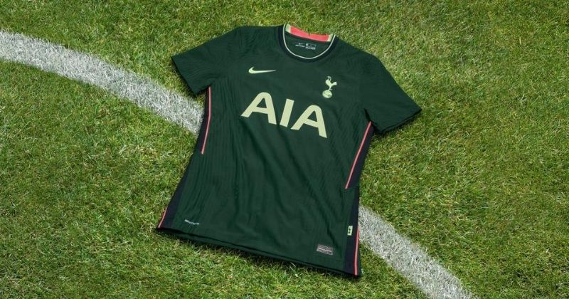 spurs 2020-21 away kit on a patch of grass
