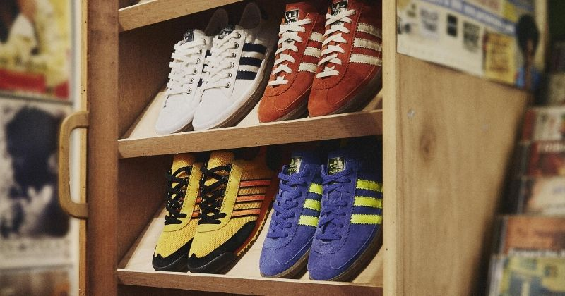 selection of adidas spezial trainers arranged on a wooden display shelf