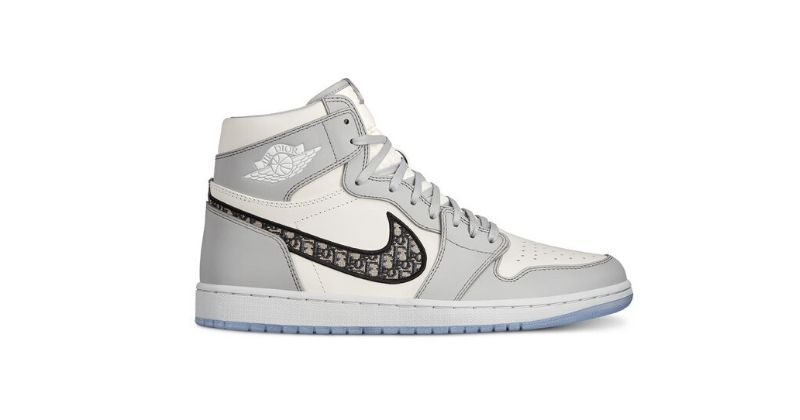 Dior x Nike Air Jordan 1 High OG in white and light grey with black swoosh on white background