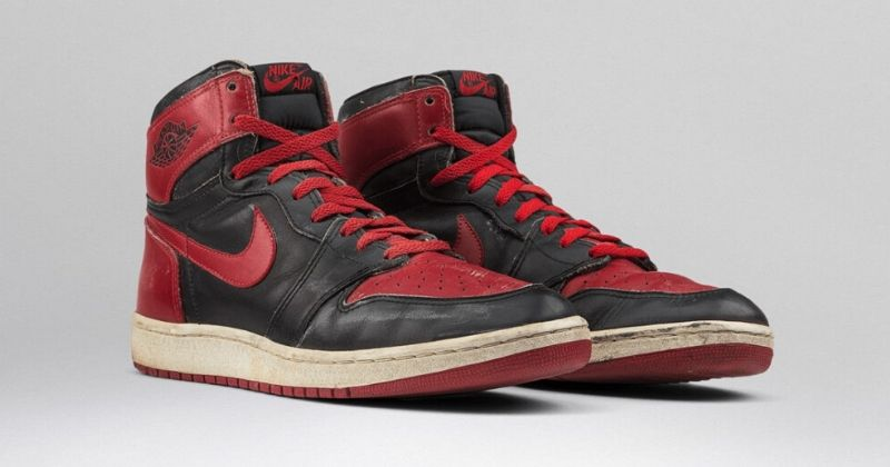 1985-85 Nike Air Jordan 1 in red and black on light background