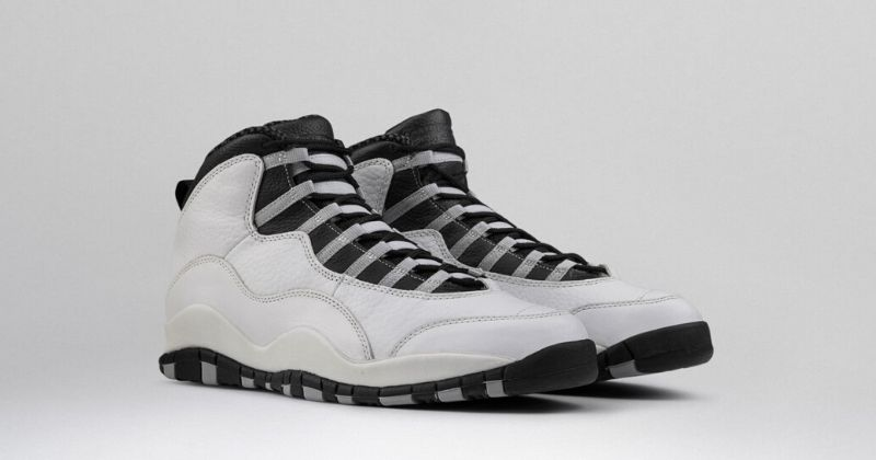 1994 Nike Air Jordan 10 in white with black detail and grey lace strapping on light background