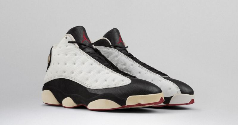 1997 Nike Air Jordan 13 in black and white with white sole detail on light background