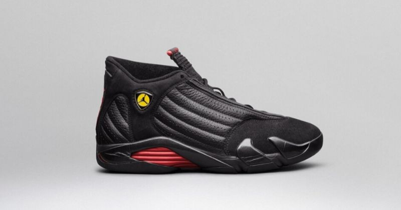 1997-99 Nike Air Jordan 14 in black with red sole detail and yellow Ferrari-style Jumpman badge on light background