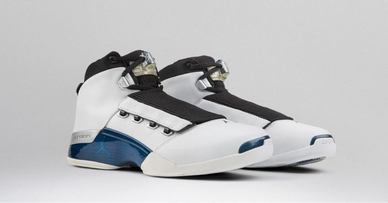 2002 Nike Air Jordan 17 in white with blue sole detail and strap over laces on light background