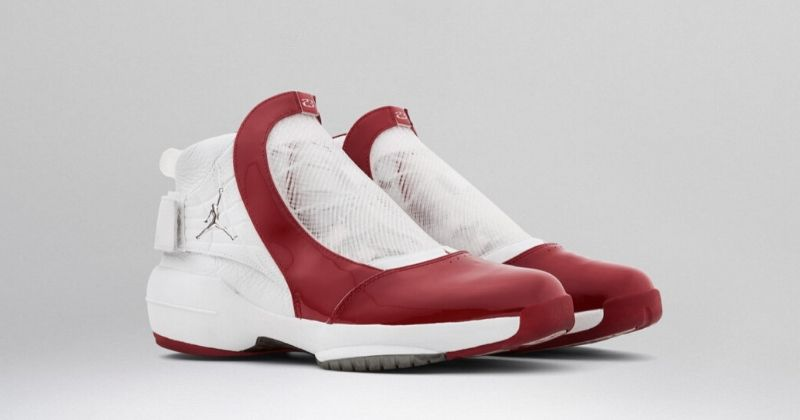 2004 Nike Air Jordan 19 in white and red with mesh cover over laces on light background