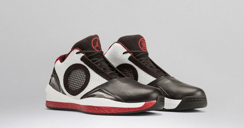 2010 Nike Air Jordan 25 2010 in black and white with red sole and circle mesh upper on light background