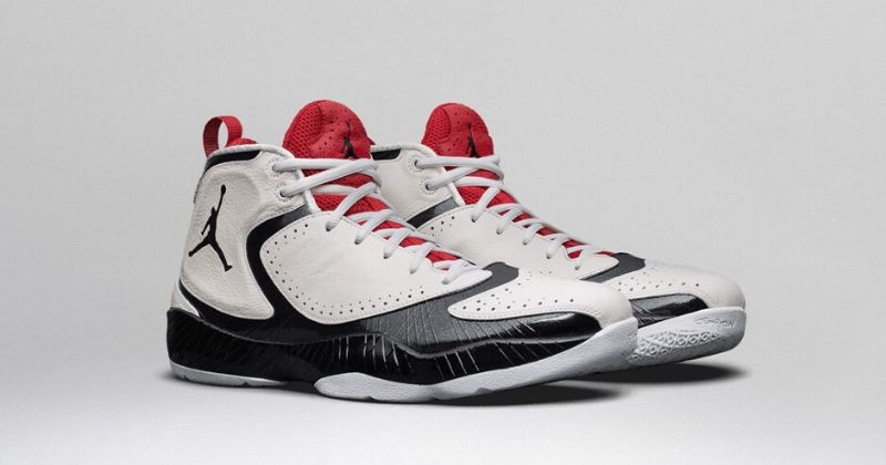 2012 Nike Air Jordan 27 2012 in white with red tongue detail and black patent sole on light background