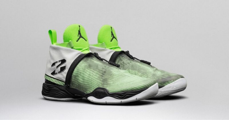 2013 Nike Air Jordan 28 in white and neon green tongue on light background
