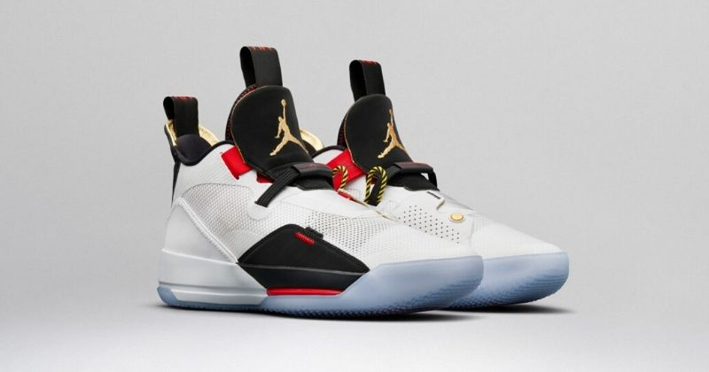 2018 Nike Air Jordan 33 in white with black and gold detail and laceless technology on light background