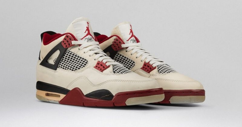 1989 Nike Air Jordan 4 in white red and black with upper mesh detail on light background