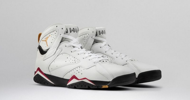 1992 Nike Air Jordan 7 in white with black sole and gold Jumpman logo on light background