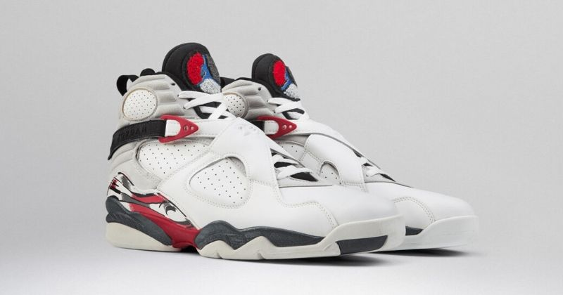 1992 Nike Air Jordan 8 in white with crossover strapping red and white detail on light background