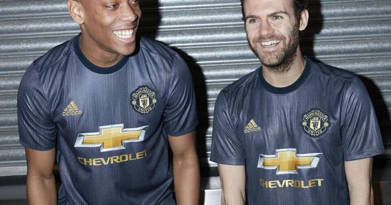 black man united home kit worn by anthony martial and juan mata