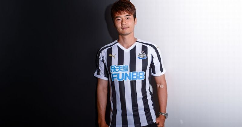 black and white newcastle home kit worn by ki seung yung