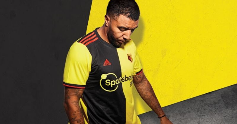 troy deeney wearing the yellow and black 2019-20 watford home shirt