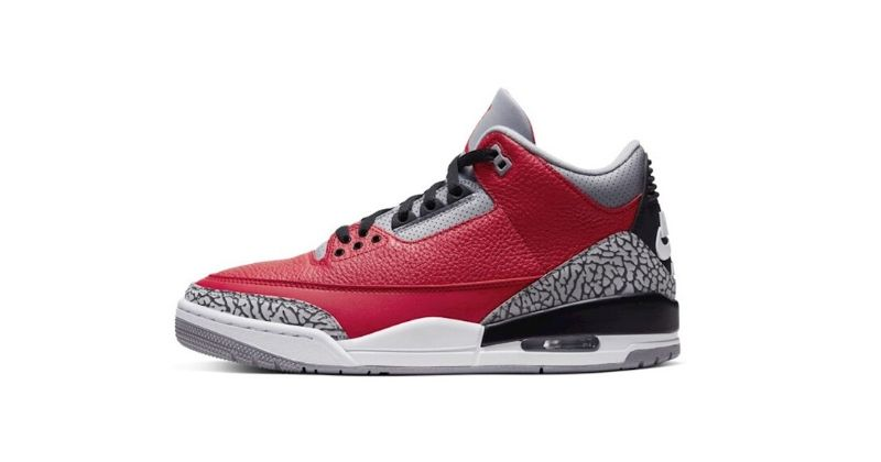 Nike Air Jordan III 3 in red with animal print detail on white background
