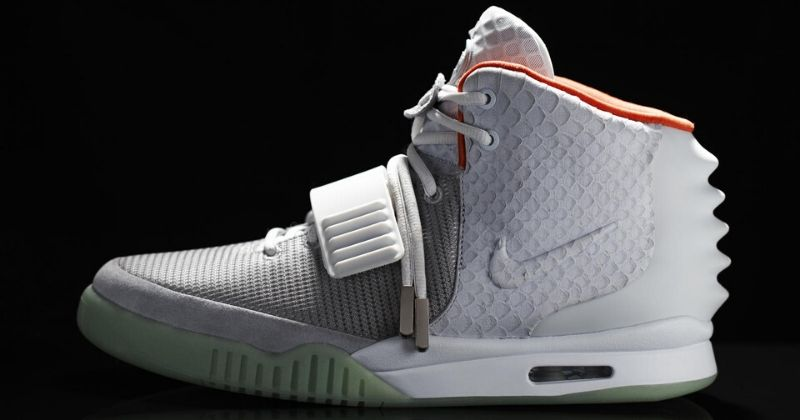 collection of Nike Air Yeezy 2 in white on black background