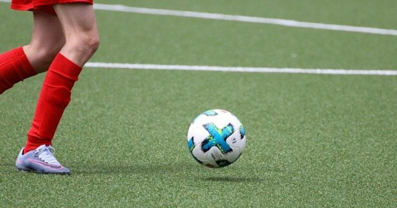 image of a football sitting on a 2G astro turf football pitch
