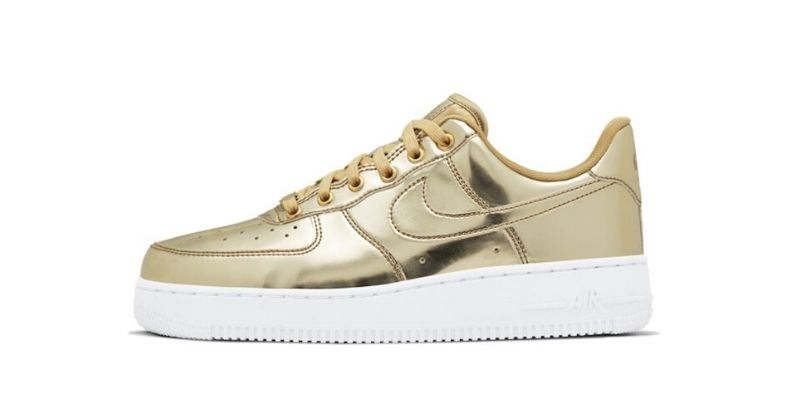 Nike Air Force 1 womens shoe in gold with white sole