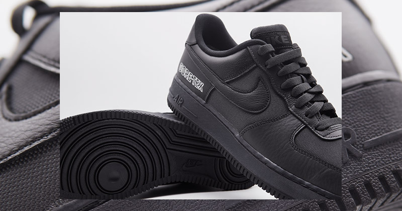 nike air force one gtx trainer in black from the side view
