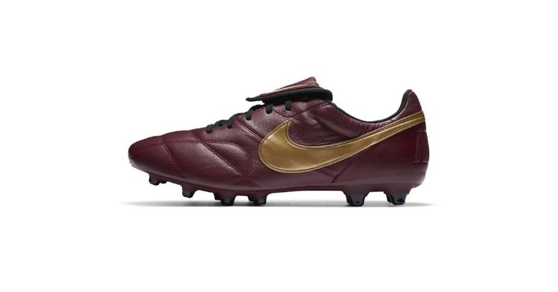 dark red and gold nike premier II football boots