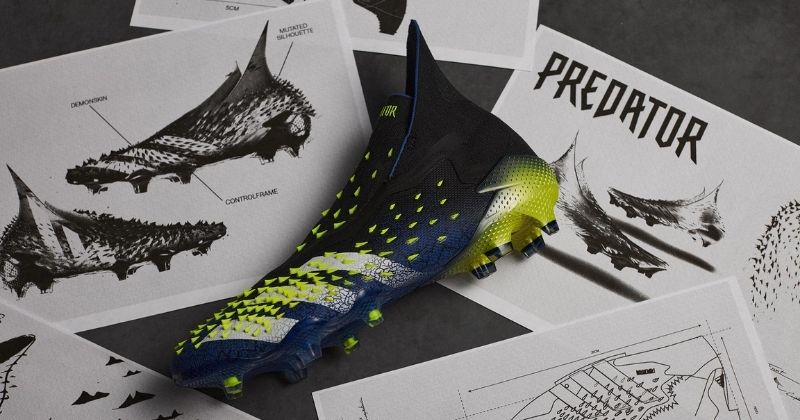 adidas predator freak displayed on a table