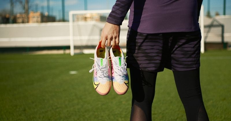 nike mercurial dragonfly being held on the pitch
