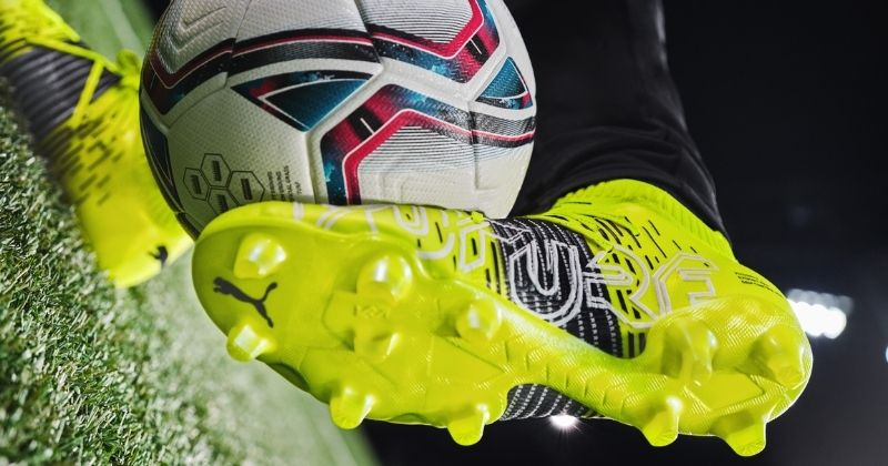 puma future z controlling a football on grass